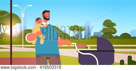 Father Walking Outdoor With Little Baby Son Fatherhood Parenting Concept Dad Spending Time With His