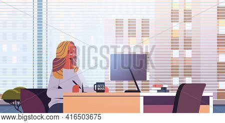 Young Businesswoman Sitting At Workplace And Using Computer Businesswoman Working In Office