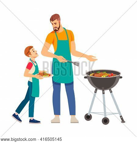 Father And Son Having A Barbecue Party In Their Garden. Happy Family Having Barbecue Party At Summer