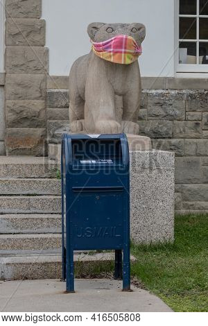 Mammoth Hot Springs, United States: July 28, 2020: Masked Statue With Post Office Box