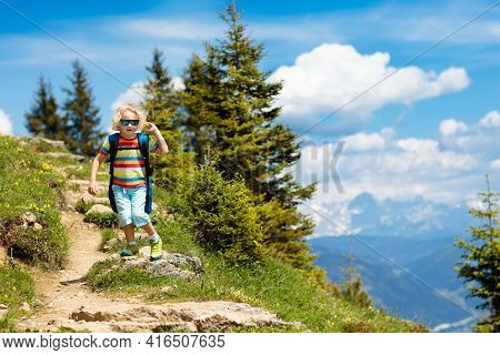 Children Hiking In Alps Mountains. Kids Look At Snow Covered Mountain In Austria. Spring Family Vaca