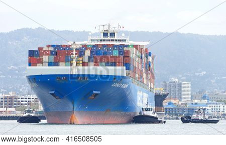 Oakland, Ca - Apr 3, 2021: Multiple Tugboats Work In Tandem To Assist Cargo Ship Cosco Europe To Tur