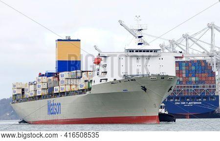 Oakland, Ca - Apr 5, 2021: Multiple Tugboats Assisting Cargo Ship Matson Manoa To Maneuver Into The