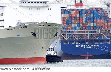 Oakland, Ca - Apr 5, 2021: Tugboat Assisting Matson Cargo Ship Manoa To Maneuver Into The Port Of Oa