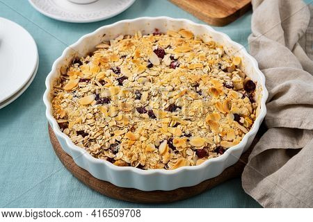 Whole Apple And Pear Crumble With Ice Cream, Streusel. Sweet Dessert With Stewed Fruit Topped Crisp