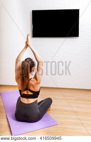 Laptop Screen Video Of Yoga Exercise At Home. Young Woman Workout, Practicing Yoga In Room, Relaxing