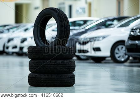 New Tires That Change Tires In The Auto Repair Service Center, Blurred Background, New Car Tires In