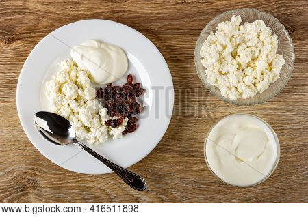 Spoon In White Plate With Cottage Cheese, Sour Cream And Raisin, Transparent Glass Bowls With Cottag