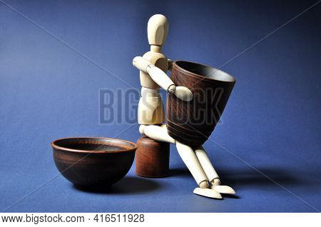 A Potter With Manufactured Brown Earthenware. Workshop