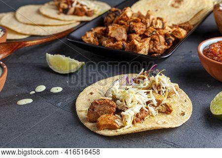 Closeup Image Of A Mexican Taco Dish With Corn Tortillas, Precooked, Preseasoned Chicken Pieces, Cab