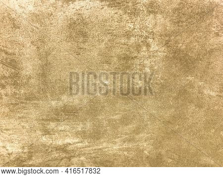 Texture Decorative Light Beige Plaster Imitating Old Peeling Wall. Obsolete Cracked Golden Stone Bac