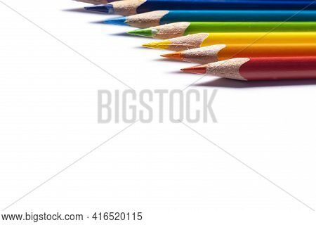 Close Up Horizontal View Of Rainbow Color Wooden Pencils With Shallow Depth Of Field On White Backgr