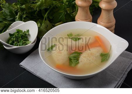 Griessnockerlsuppe. Clear Soup With Semolina Dumplings In A White Bowl. German Food.  Bavarian Cuisi