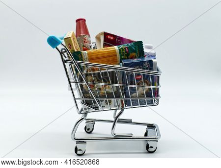 Bologna / Italy - October 27, 2020: Shopping Cart With Various Original Coop Products. Coop Is The B