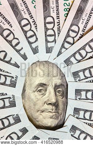 A Lot Of Folded One Hundred 100 Usd Bills Layed Like Vintage Sun Face Beams Around Benjamin Franklin