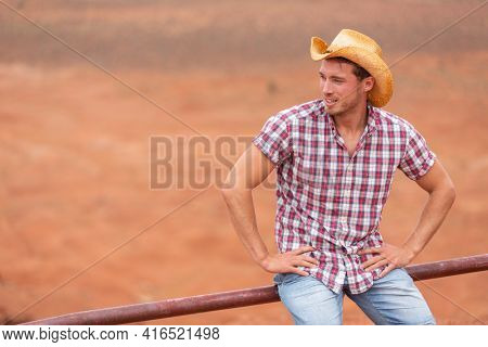 Cowboy farmer man in country side looking away at desert land countryside ranch wearing western hat. Happy American Male model in american countryside landscape nature on farm, Utah, USA.