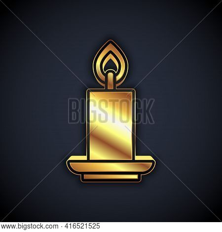 Gold Burning Candle Icon Isolated On Black Background. Cylindrical Candle Stick With Burning Flame.