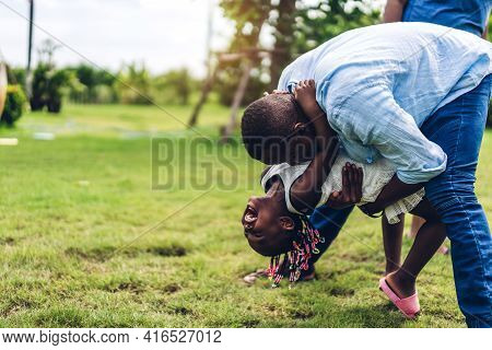 Portrait Of Enjoy Happy Love Black Family African American Father And Mother With Little African Gir