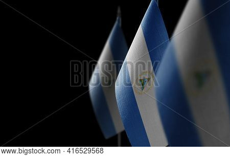 Small National Flags Of The Nicaragua On A Black Background