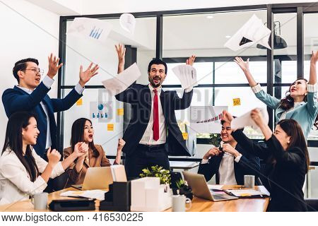 Successful Group Of Casual Business Relaxing And Throwing Paper Winning Success Agreement.creative B