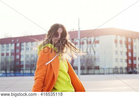 Lifestyle Portrait Of Cheerful Brunette Young Woman In Trendy Colorful Casual Outfit Looking Over Sh