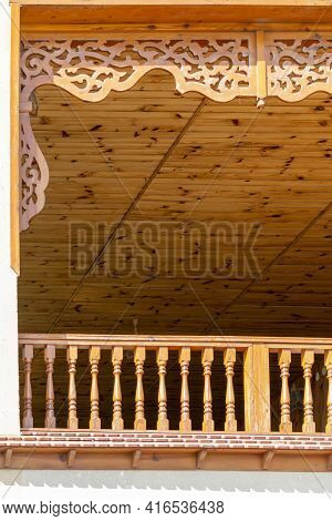 Veranda With Carved Wooden Decor. Sunny Autumn Day. Front View. Crimea, Sudak - 10 October 2020.