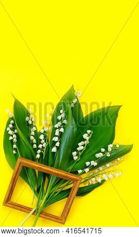 Greeting Card For Mother's Day With Bouquet Of Tender Lilies Of The Valley With Wooden Frame  On  Ye