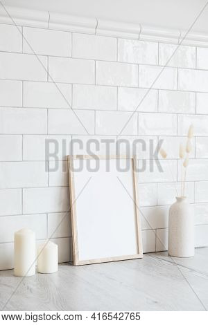 Scandinavian Room Interior With Mockup Photo Frame, Candles, Vase Of Dried Flowers. Brick Tiles Wall