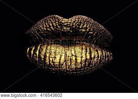 Golden Lips Closeup. Gold Metal Art Lip. Beautiful Makeup. Golden Lip Gloss On Beauty Female Mouth,