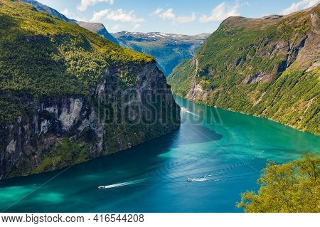Fjord Geirangerfjord With Ferry Boats, View From Ornesvingen Viewing Point, Norway. Travel Destinati
