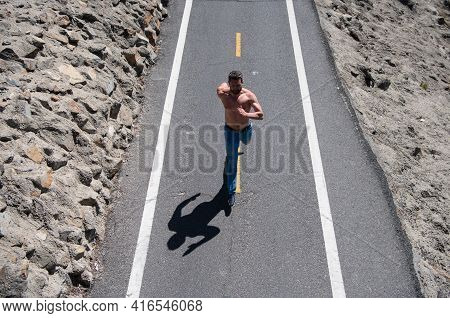Man With Bare Torso Running On The Road. Active Healthy Runner Jogging Outdoor