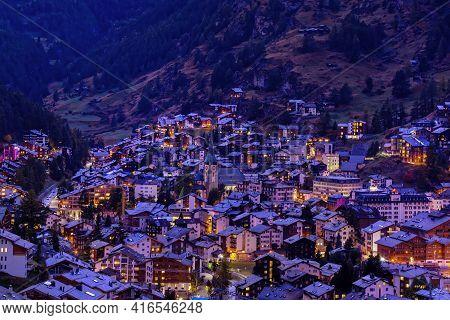 Aerial Night Panoramic View Of Zermatt Village At Dusk, Switzerland, Swiss Alps