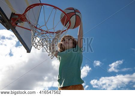 Active Kids Enjoying Outdoor Game With Basketball, Outdoor On Playground