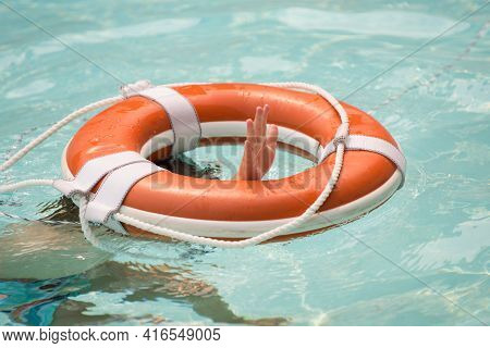 Lifebuoy Or Buoy Helping To Survive Concept. Support Survival Or Save, Rescue. Ring Floating In A Se