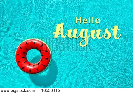 Hello August. Inflatable Ring Floating In Swimming Pool, Top View