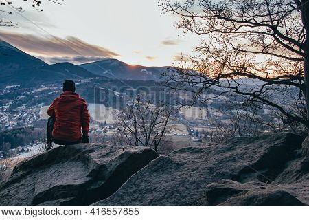 Young Boy In A Red-brown Jacket Sitting On A Bear Rock In The Beskydy Mountains Near Ostravice At Su