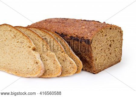 Partly Cut Rectangular Loaf Of Whole Grain Bread And Sliced Round Loaf Of Gray Bread Made With Wheat