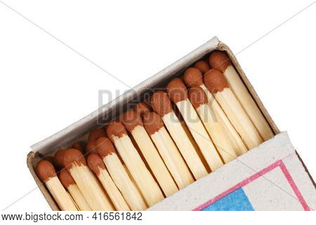 Matches With Brown Sulfur Heads In A Cardboard Box On A White Background Isolated.