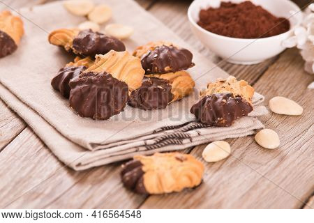 Butter Cookies With Chocolate On Wooden Table.