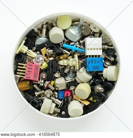 Computer Screws And Fasteners In Box On White Background. Computer Repair, Service. Close-up