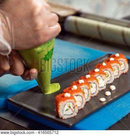 Chef Pouring Wasabi To The Sushi Table, California Unagi Sushi Roll