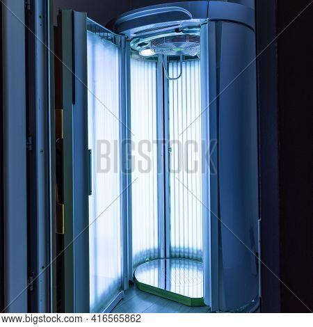 Standing Empty Solarium With Blue Light View