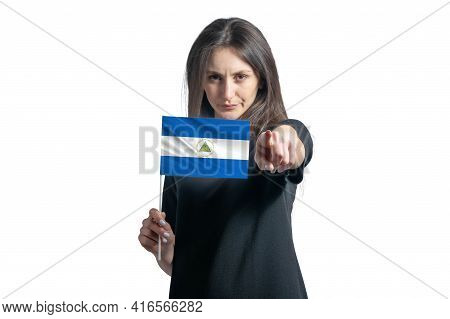 Happy Young White Woman Holding Flag Of Nicaragua And Points Forward In Front Of Him Isolated On A W