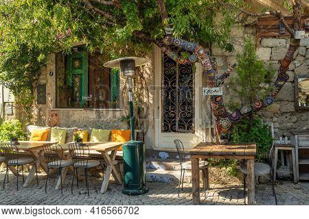 Alacati, Izmir - November 2, 2019: Cozy outdoor cafe in Alacati, Izmir. Alacati is popular historical tourist destination in Turkey.