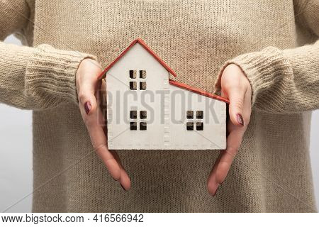 House Model In Female Hands. Own Housing, Buying Real Estate Concept.