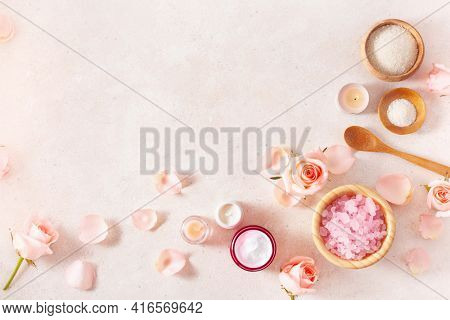 skincare products and rose flowers. natural cosmetics for home spa treatment