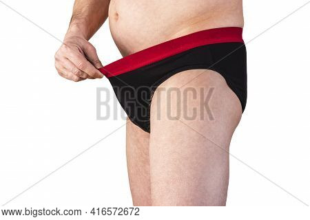 The Man Looks Into His Panties. Erection Problems. The Man Looks At His Genitals. Isolated White Bac