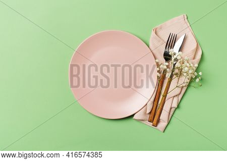Spring And Mothers Day Table Layout With Plate And Tableware On Green Background, Flat Lay, Copy Spa