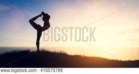 Woman in yoga pose meditation at sunset. Zen, well-being and body care. 3D illustration