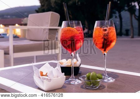 Italian Refreshing Aperitif With Snacks On A Summer Evening